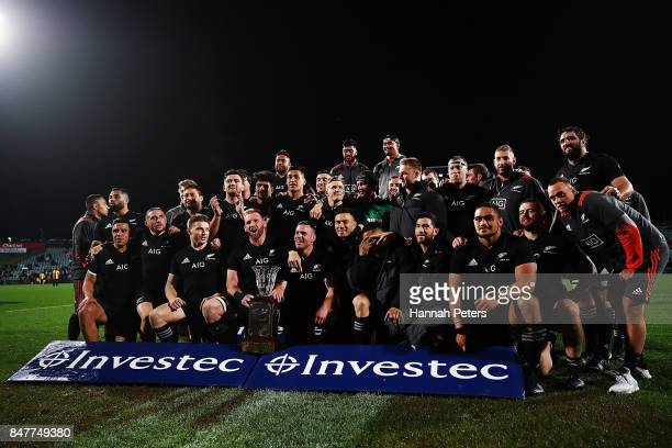 The All Blacks celebrate with the Freedom Cup after winning the Rugby Championship match between the New Zealand All Blacks and the South African...