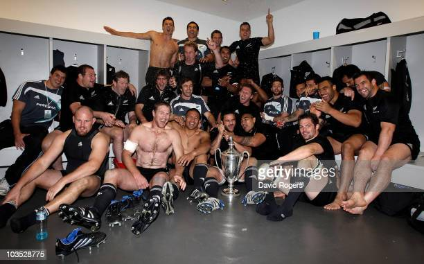 The All Blacks celebrate with the Tri Nations trophy after their victory in the 2010 TriNations match between the South African Springboks and the...