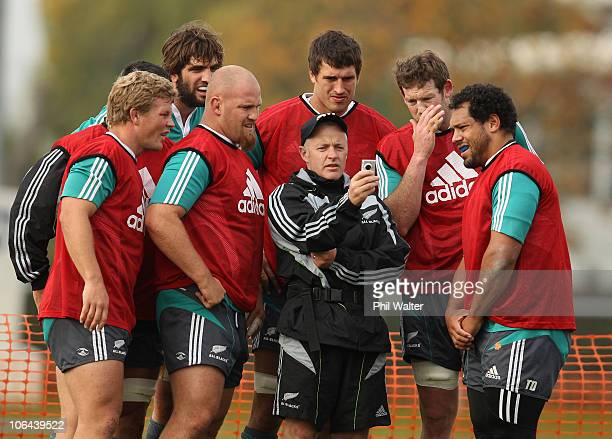 The All Blacks gather togeather to watch footage from Physiotherapist Peter Gallagher during a New Zealand All Blacks training session at Latymers...