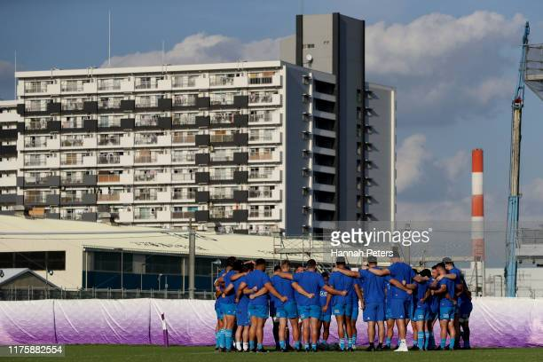 The All Blacks huddle during a New Zealand All Blacks Rugby World Cup Captain's Run at Tatsuminomori Seaside Park on September 20, 2019 in Tokyo,...