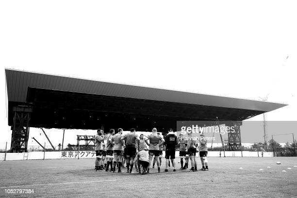 The All Blacks huddle during a New Zealand All Blacks training session on October 23 2018 in Tokyo Japan