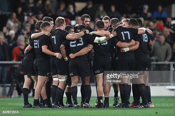 The All Blacks huddle togather during the International Test match between the New Zealand All Blacks and Wales at Forsyth Barr Stadium on June 25...