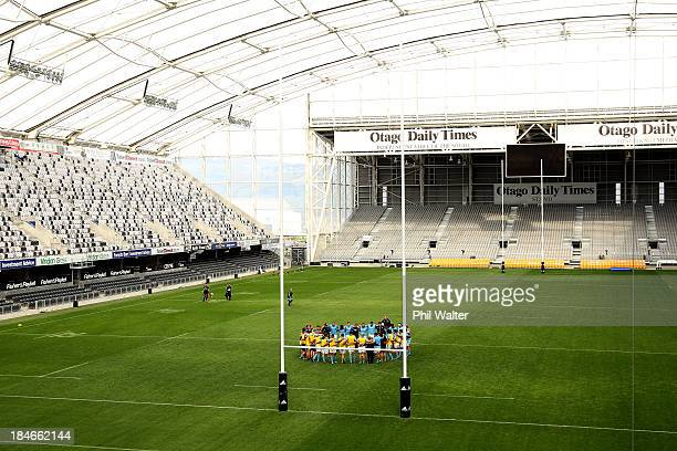 The All Blacks huddle togeather during a New Zealand All Blacks training session at the Forsyth Barr Stadium on October 15 2013 in Dunedin New Zealand