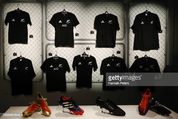 The All Blacks jerseys over time are displayed during the New Zealand All Blacks Adidas Jersey launch on October 31 2018 in Tokyo Japan