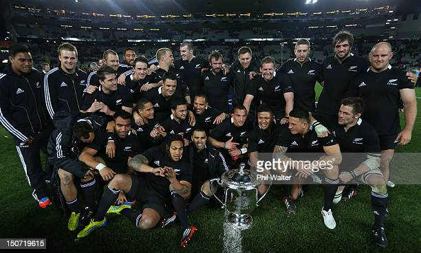 The All Blacks pose with the Bledisloe Cup following The Rugby Championship Bledisloe Cup match between the New Zealand All Blacks and the Australian...