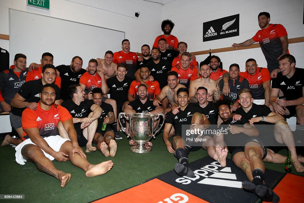 The All Blacks pose with the Bledisloe Cup in the dressing room following The Rugby Championship Bledisloe Cup match between the New Zealand All Blacks and the Australia Wallabies at Forsyth Barr Stadium on August 26, 2017 in Dunedin, New Zealand.