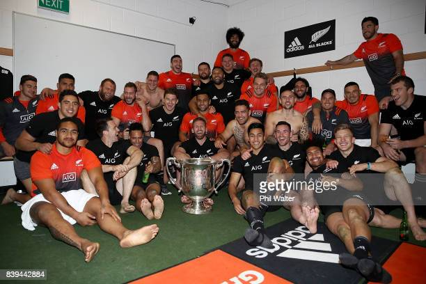 The All Blacks pose with the Bledisloe Cup in the dressing room following The Rugby Championship Bledisloe Cup match between the New Zealand All...