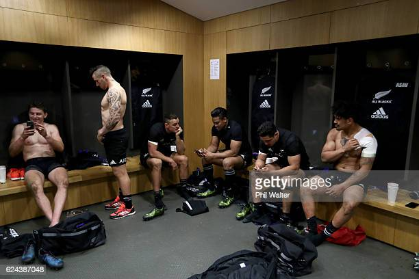 The All Blacks relax in the dressing room following the international rugby match between Ireland and the New Zealand All Blacks at Aviva Stadium on...