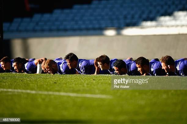 The All Blacks warm up before a New Zealand All Blacks training session on August 13 2015 in Auckland New Zealand