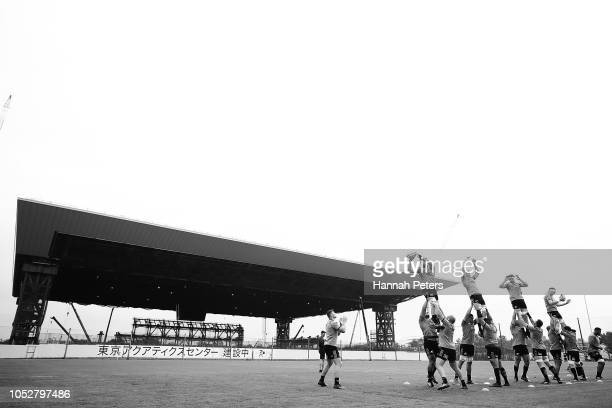 The All Blacks warm up during a New Zealand All Blacks training session on October 23 2018 in Tokyo Japan