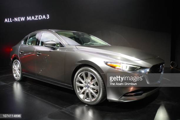The all new Mazda3 is seen onstage during the Mazda press conference prior to the LA Auto Show on November 27 2018 in Los Angeles California