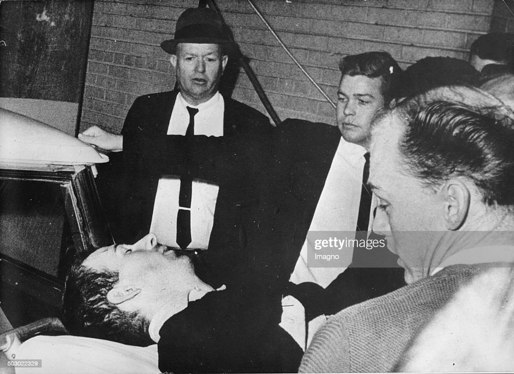 The alleged assassin Lee Harvey Oswald is being removed on strecher after being shot by the nightclub operator Jack Ruby two days after he had murdered President John F. Kennedy. Dallas. Texas. 24th November 1963. Photograph.