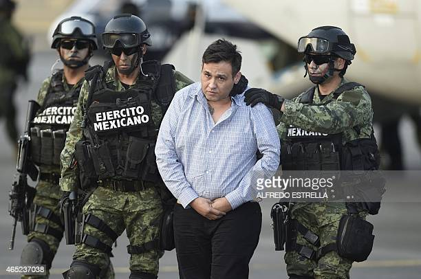 The alleged leader of the Zetas drug cartel Oscar Omar Trevino aka Z42 is taken under custody to be presented to the press at the Attorney General...