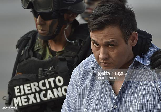 "The alleged leader of the Zetas drug carteL, Oscar Omar Trevino, aka ""Z-42"" is taken under custody to be presented to the press at the Attorney..."