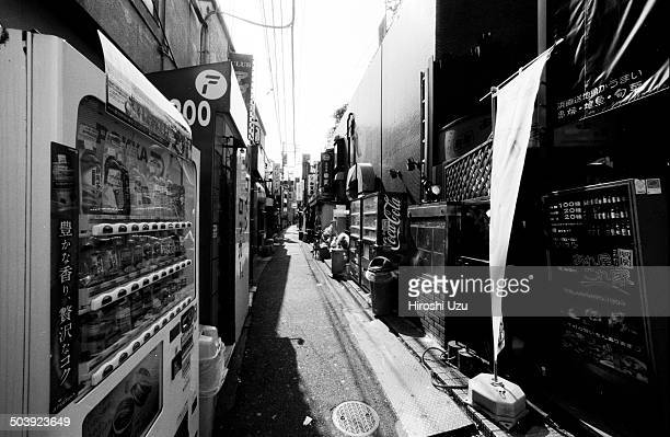 CONTENT] The alley in Kitasenju with many vending machines and small bars