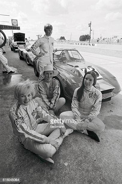 The all-girl racing team from Ring Free Motor Oil pose in front of their prototype Austin Healey before taking on the grueling 12 Hours of Sebring....