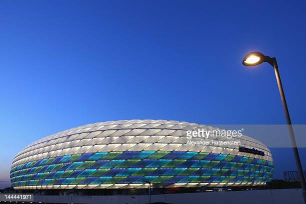 The Allianz Arena is illuminated with white green and blue lights ahead of the UEFA Champions League Final between FC Bayern Munich and Chelsea on...