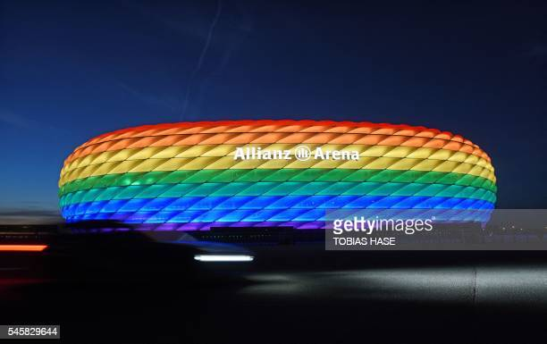 The Allianz arena is lit with Rainbow colours on behalf of the Christopher Street days in Munich, southern Germany, on July 9, 2016. - Around 10000...