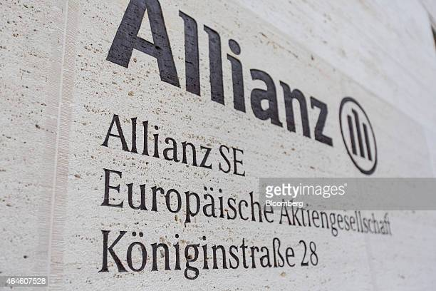The Allianz logo sits on an exterior wall at the headquarters of Allianz SE in Munich Germany on Thursday Feb 26 2015 Allianz reported an unexpected...