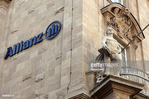 The Allianz SE logo hangs on an Allianz branch in Quedlinburg Germany on Sunday May 24 2009 Allianz SE Europes biggest insurer is delaying plans to...