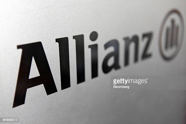 The Allianz SE logo is seen on the door of an Allianz branch in Quedlinburg Germany on Sunday May 24 2009 Allianz SE Europes biggest insurer is...