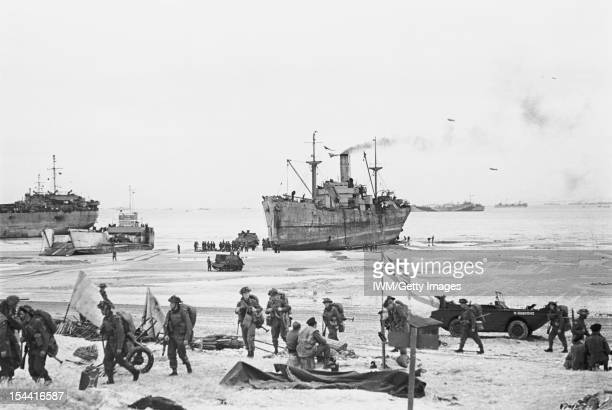 The Allied Campaign In NorthWest Europe 6 June 1944 7 May 1945 DDay 6 June 1944 The White Ensign of a Naval Beach Party flying on the Normandy Coast...