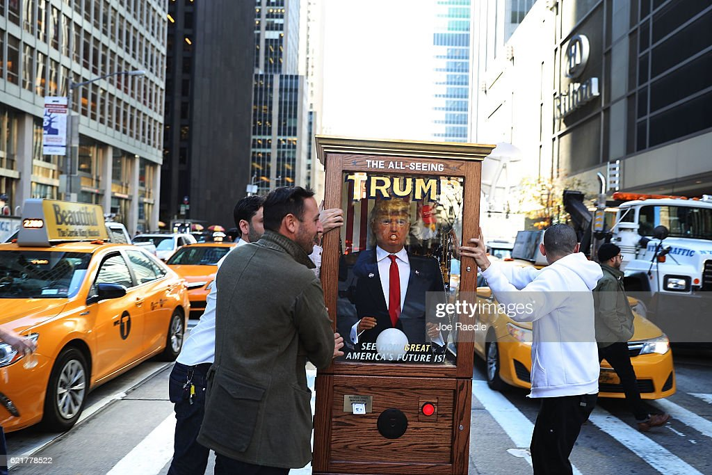 'The All-Seeing Trump,' a parody of a fortune-telling machine is seen near where the election night party for Republican presidential candidate Donald Trump will be held at the New York Hilton Midtown on November 8, 2016 in New York City. Voters head to the polls to decide the next President of the United States.