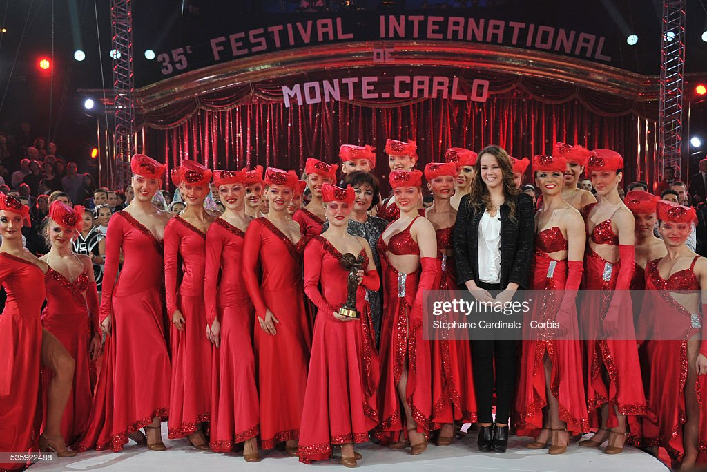 The Alma's troupe performers from Romania receive the 'Bronze Clown' award from Princess Stephanie's daughter Pauline Ducruet (C) during the official Award Gala evening of the 35th Monte Carlo International Circus Festival.