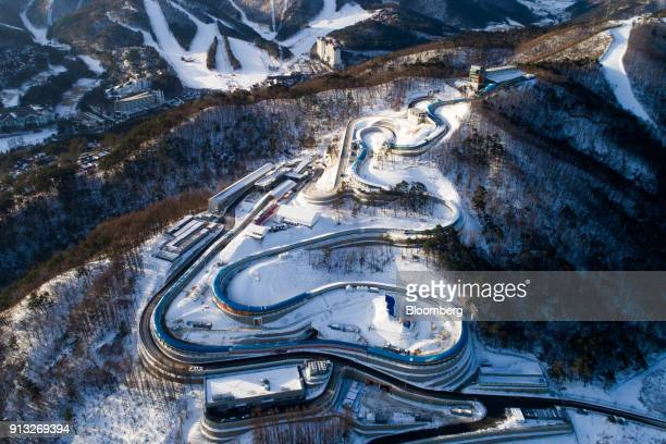 The Alpensia Sliding Center the venue for luge bobsleigh and skeleton events at the 2018 PyeongChang Winter Olympic Games stands in this aerial...