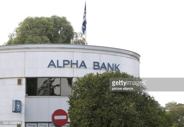 The Alpha Bank logo on the side of a building in Nicosia Cyprus 17 September 2015 PHOTO FRISO GENTSCH/DPA | usage worldwide