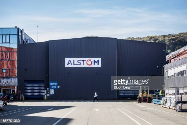 The Alstom SA logo sits on the exterior of the Alstom railway train factory in Belfort, France, on Thursday, Oct. 26, 2017. The creation of a...