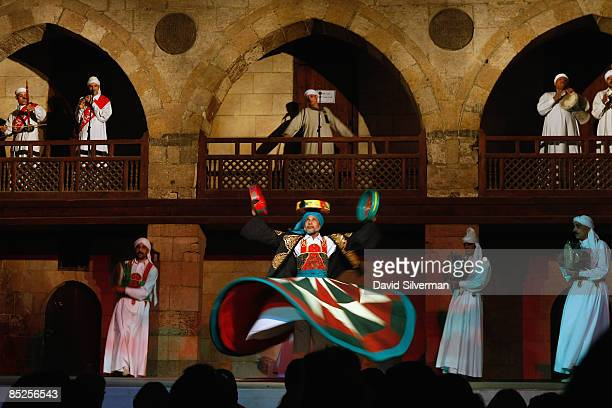 The alTannoura troupe performs Sufi ritual whirling dances in the Mamluk 16th century Wikalat alGhuri February 21 2009 in Cairo Egypt Despite being...