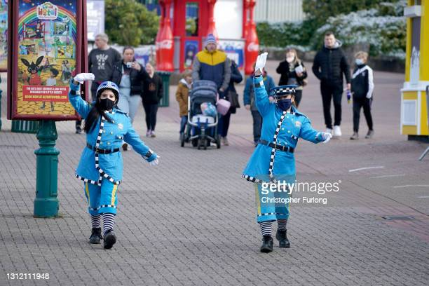 The Alton Towers traffic patrol greet thrill seekers as the gates open on the first day opening after after lockdown restriction were eased on April...