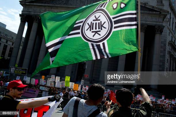 The altright Kekistan flag is flown at an Act for America rally to protest sharia law on June 10 2017 in Foley Square in New York City Members of the...
