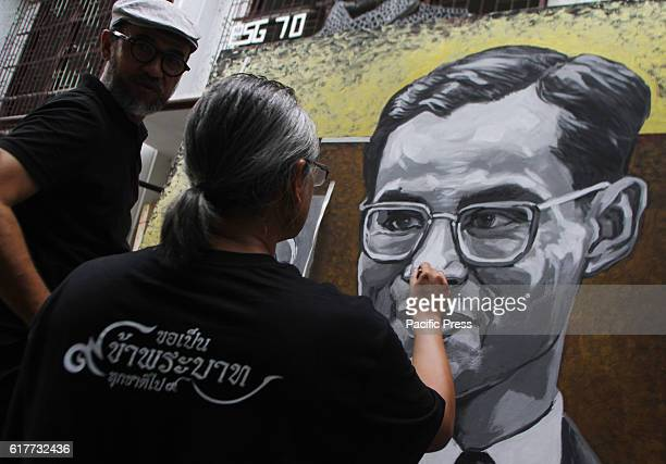 The alumni faculty of painting sculpture and Graphic Arts from Silpakorn University paint portraits of Thai King Bhumibol Adulyadej as part of...
