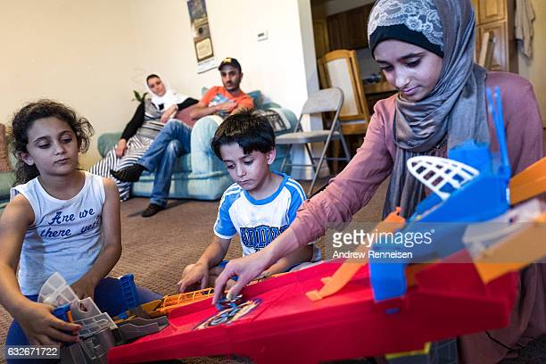 The AlZoobi family spends time together inside their home on July 26 2015 in Bloomfield Hills Michigan They fled Syria three years ago and have lived...