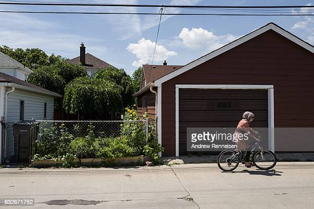The AlZoobi family spends time together outside their home on July 26 2015 in Bloomfield hills Michigan They fled Syria three years ago and have...