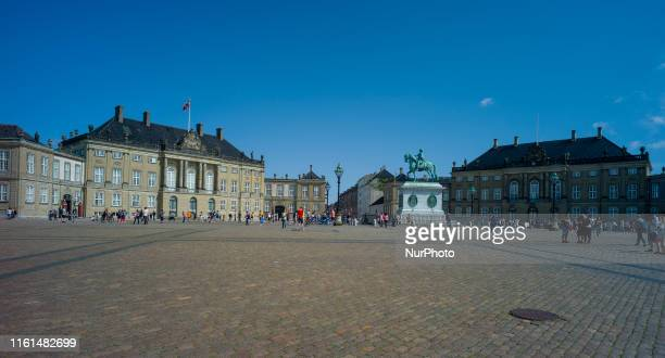 The Amalienborg Palace in Copenhagen. It is composed of four Rococo-style buildings, made by the architect Nicolai Eigtved in 1768,. Currently, the...