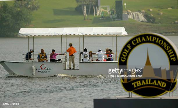 The Amata boat takes players out to the 9th island green during day two of the Thailand Golf Championship at Amata Springs Country Club on December...