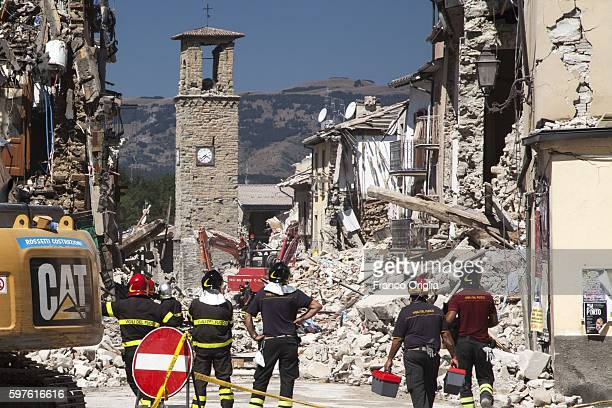 The Amatrice clocktower stands among the ruins in the center of the town on August 28 2016 in Rieti Italy At least 290 people are now known to have...