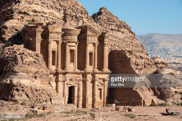 the amazing ad deir, the monastery with blue sky in petra, jordan - jordanian stock pictures, royalty-free photos & images