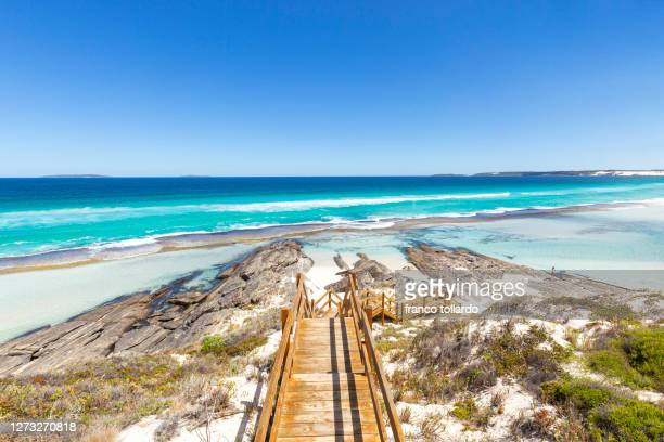 the amazing beaches in esperance, with shallow water, blue sky, blue colors of indian ocean and rocks - australia stock pictures, royalty-free photos & images