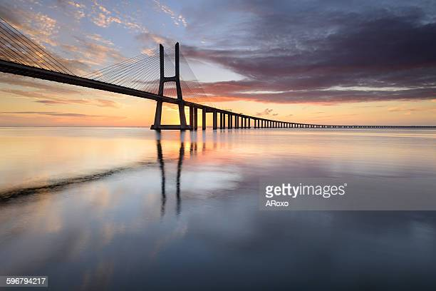 The amazing bridge in Lisbon at sunrise