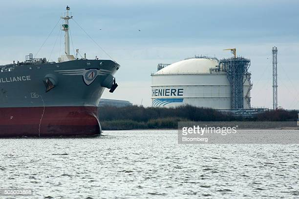 The Amazon Brilliance oil tanker sails past a storage tank at the Cheniere Energy Inc liquefied natural gas terminal in Sabine Pass Louisiana US on...