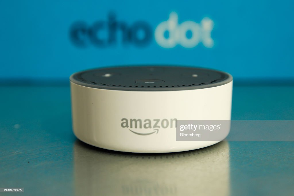 The Amazon 'Echo Dot' device sits during the U.K. launch event for the Amazon.com Inc. Echo voice-controlled home assistant speaker in London, U.K., on Wednesday, Sept. 14, 2016. The Seattle-based company today announced that its Echo product line will be available in the U.K. and Germany starting in the fall, the first time the gadget will be available outside the U.S. Photographer: Luke MacGregor/Bloomberg via Getty Images