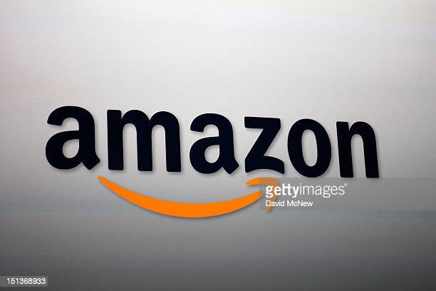 The Amazon logo is projected onto a screen at a press conference on September 6 2012 in Santa Monica California Amazon unveiled the Kindle Paperwhite...