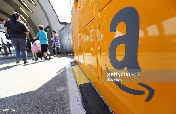 The Amazon logo sits on an Amazoncom Inc pickup and collect locker at Newbury Park railway station in Newbury Park UK on Wednesday July 23 2014 UK...