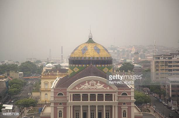 The Amazon Theatre is seen amidst a cloud of smoke in Manaus Amazonas State Brazil on October 19 2015 According to the National Institute for Space...