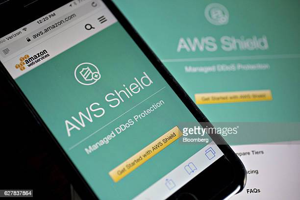 The Amazoncom Inc Amazon Web Services Shield website is displayed on an Apple Inc iPhone and iPad in Washington DC US on Monday Dec 5 2016 Amazoncom...