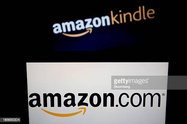 The Amazoncom Inc and Amazon Kindle logos are displayed on laptop computers in Washington DC US on Wednesday Oct 23 2013 Amazoncom Inc is scheduled...